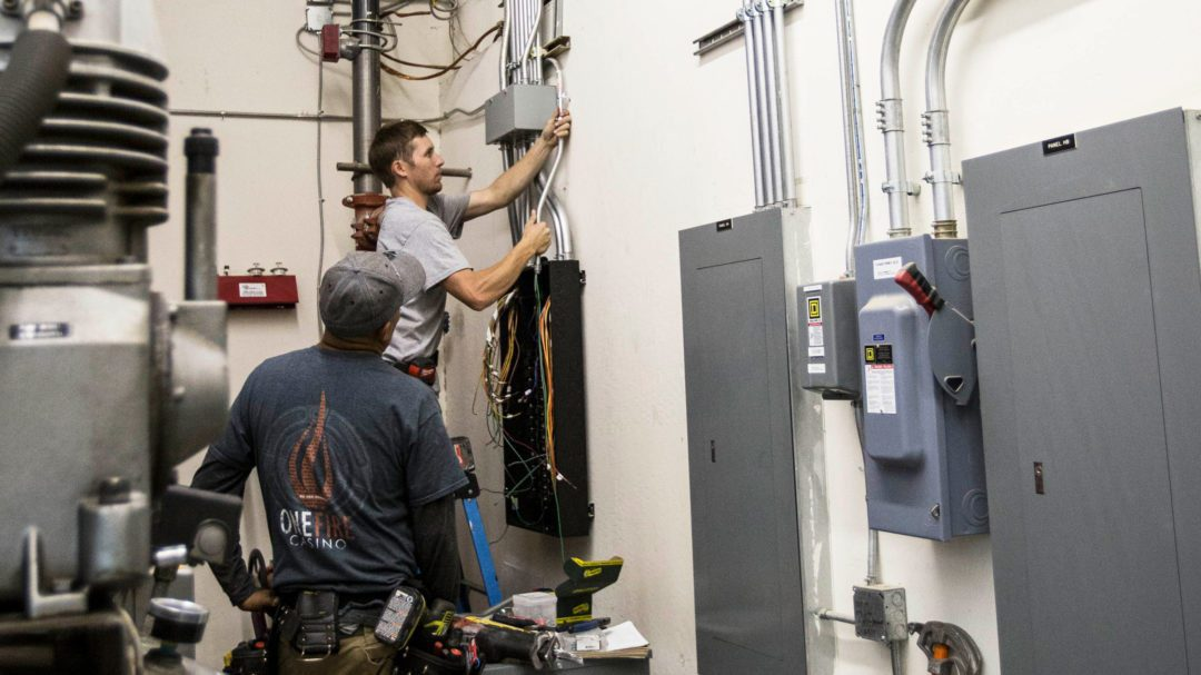 Colonial electric technicians working on an commercial electrical panel upgrade